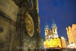 The Prague Astronomical Clock or Prague Orloj with the gothic T�n Cathedral illuminating the background
